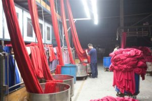 Coils and bundles of cloth in a production chamber of the Guotai Dyeing Factory (English name; Well Dyeing Factory Ltd.) in the Gaoping Industrial Park, in Sanjiao town, Zhongshan City.